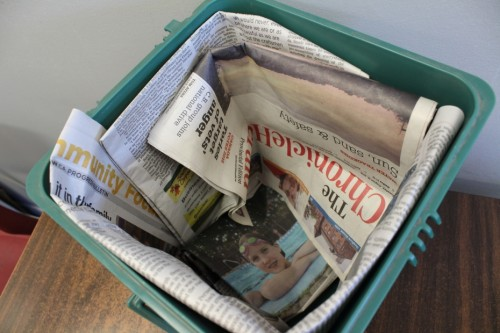 Line Your Kitchen Bin with Newspaper--Food Waste Slides Out Easily.